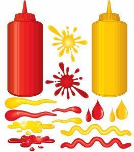 Botellas de spray de salsa picante sobre fondo blanco.